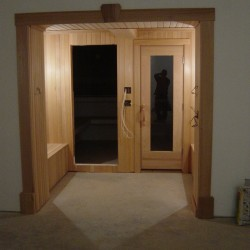 Home Sauna Kits - Custom home sauna with changing room and benches with hidden storage space