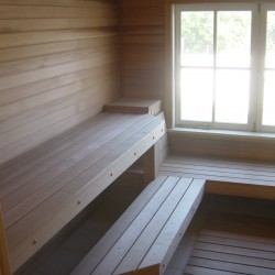 Home Sauna Kits - Custom home sauna with corner table and large window