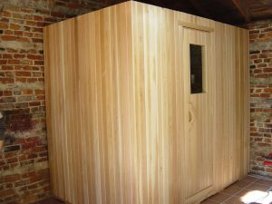 portable home sauna in basement corner