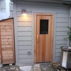 Outdoor sauna with cedar storage space