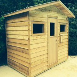 Custom Outdoor Sauna with rustic siding